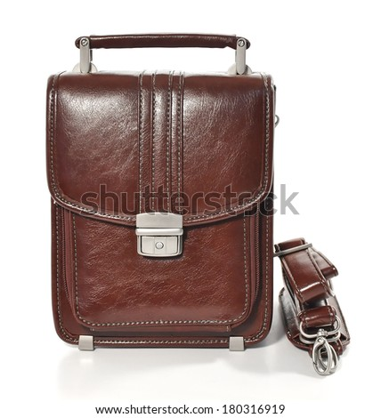 leather bag with shoulder strap, isolated on white background - stock photo