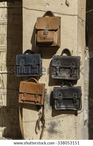 Leather bags in Marrakesh market - stock photo