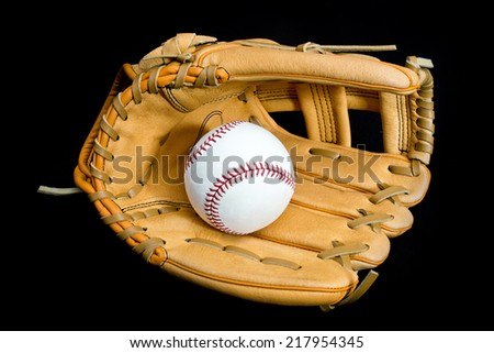 Leather baseball glove and ball on black background - stock photo