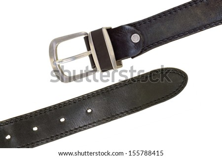 Leather belt with metal buckle on white background - stock photo