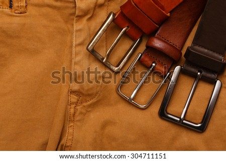Leather belts and pants - stock photo