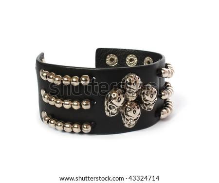 leather black bracelet with skulls - stock photo