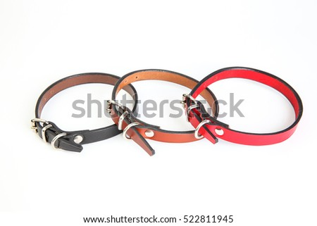 Leather black, red, brown dog collars on a white background