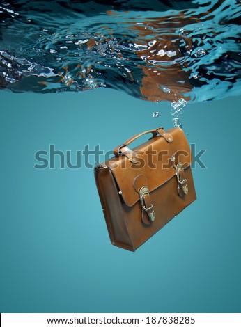 Leather Briefcase Sinking Underwater - stock photo