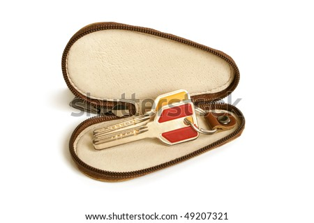 Leather case for keys on a white background - stock photo