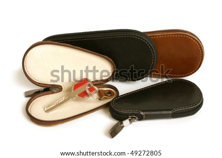 Leather cases for keys on a white background - stock photo