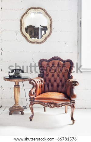 leather chair in white room interior - stock photo
