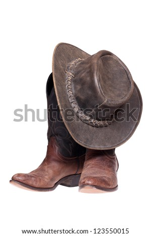 Leather cowboy boots and hat isolated on the white background with clipping path. - stock photo
