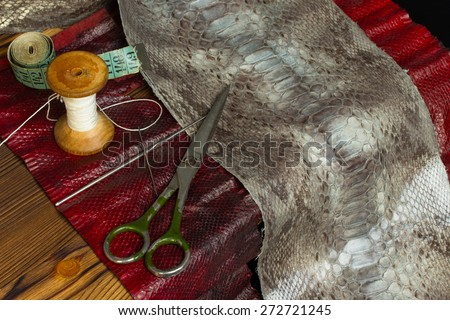 Leather craft tool - craft leather goods working with python snake leather - stock photo