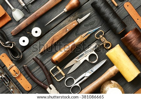 Leather crafting DIY tools flat lay still life  - stock photo