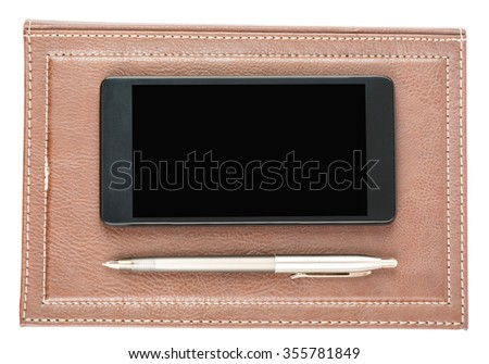 Leather daily planner with pen and smartphone on isolated white background - stock photo