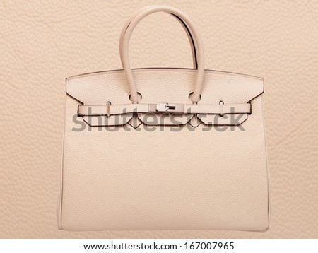Leather female handbag, accessory on against skin background without people. - stock photo