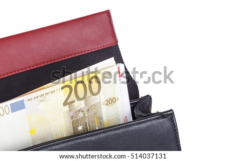 Leather handbag with euro money banknotes inside, isolated on white background.