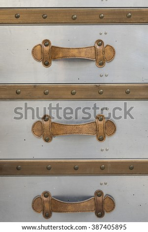 Leather handles of the vintage drawer - stock photo