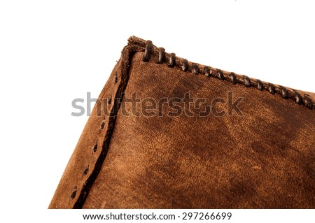 Leather Handmade Stitch, Making of Bag Design (Brown Tan). Handcrafted Leather, Hand Sewing and Stitching. Rustic Style. Isolated on White Background. - stock photo