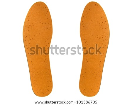 Leather insoles on a white background. - stock photo