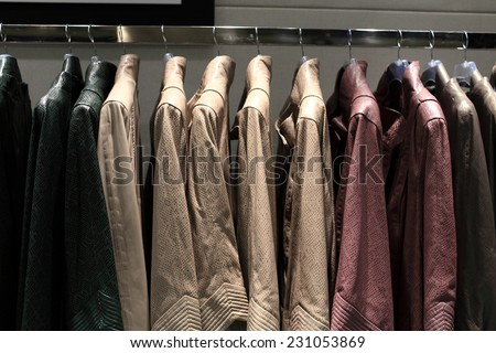 Leather jackets on the hangers at the store - stock photo