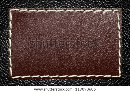 Leather Label on a Black Skin Texture - stock photo