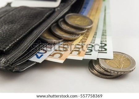 Leather men's open wallet with euro banknotes bills, coins and credit card inside isolated on white background