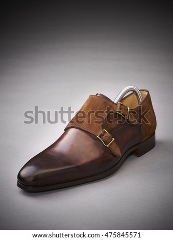 leather men shoe on gray background.