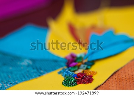 Leather petals, Bisser and pearl jewelry to create - stock photo