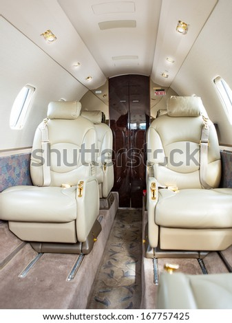 Leather seats on private jet airplane - stock photo