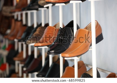 Leather shoes at a tailor shop - stock photo