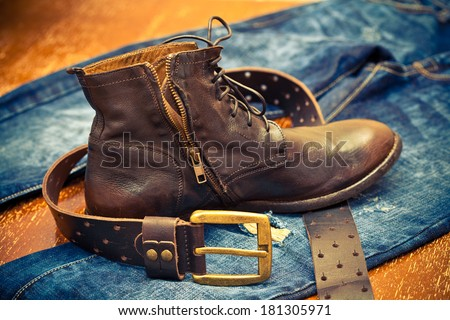 leather shoes, leather belt with a gold buckle, jeans. Cowboy style. Vintage. - stock photo