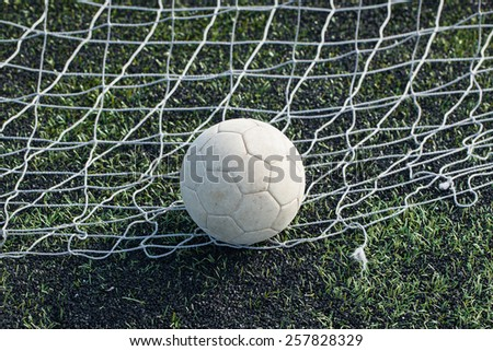 leather soccer ball in the net - stock photo