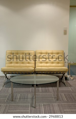 Leather sofa and glass table at waiting corner - stock photo