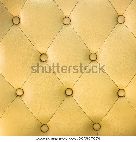 leather sofa color yellow background - stock photo