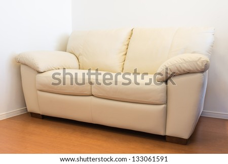 Leather sofa furniture in room - stock photo