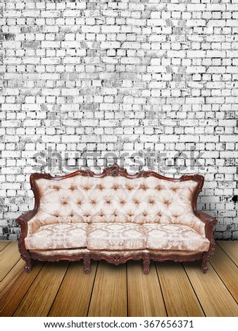 leather sofa in brick room - stock photo