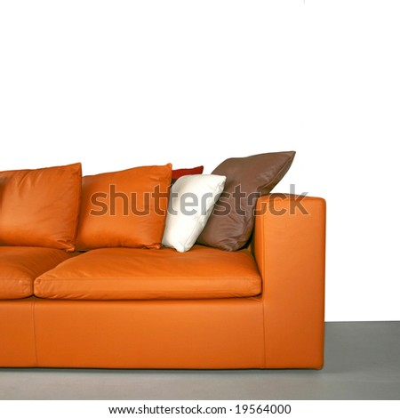 Leather sofa with pillows isolated on white