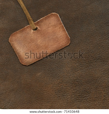 Leather tag on the background of suede