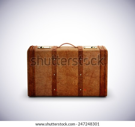 leather travel bag on a gray background - stock photo