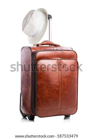 Leather travel suitcase with hat isolated on white - stock photo