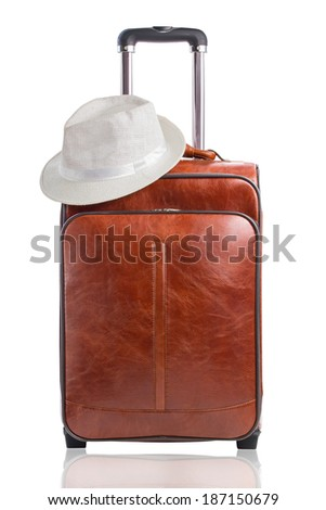 Leather travel suitcase with white hat isolated on a white background - stock photo