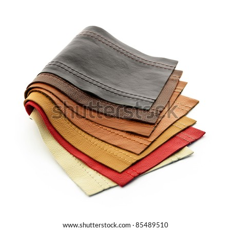 Leather upholstery samples with stitching in various colors isolated - stock photo