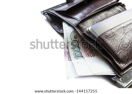 Leather wallet with credit cards and rouble banknotes of different values isolated over white - stock photo