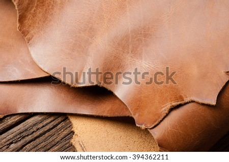 leather working, closeup details of brown leather - stock photo