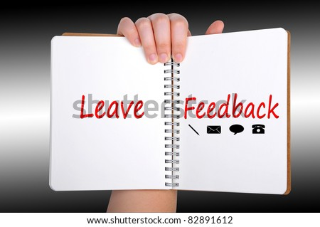 Leave Feedback words on book - stock photo