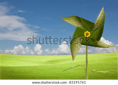 leave windmill on meadow - stock photo