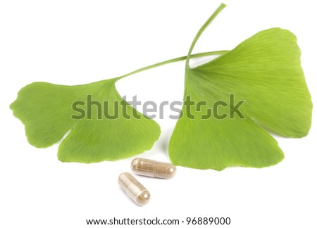 Leaves of a Ginko tree with pills
