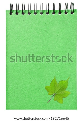 leaves on ring binder green book isolated on white background, clipping path - stock photo