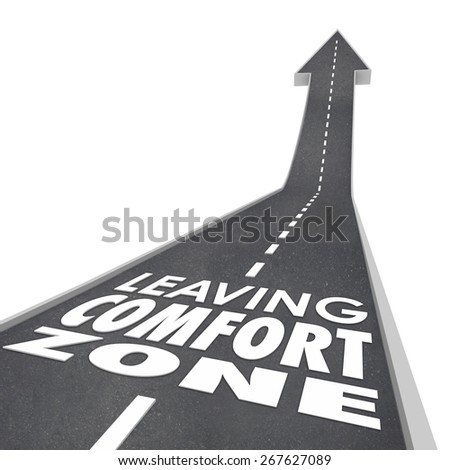 Leaving Comfort Zone words on a 3d road leading you to experience new things, to grow and improve in job, career or life - stock photo