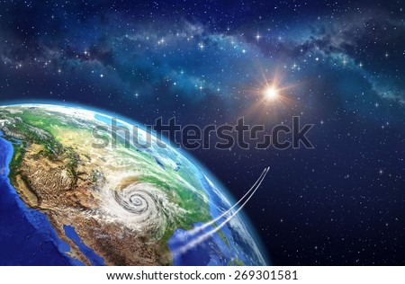 Leaving Earth. Very high definition picture of planet earth in outer space. Spacecrafts lifting off from USA soil, hit by a cyclone. Elements of this image furnished by NASA - stock photo