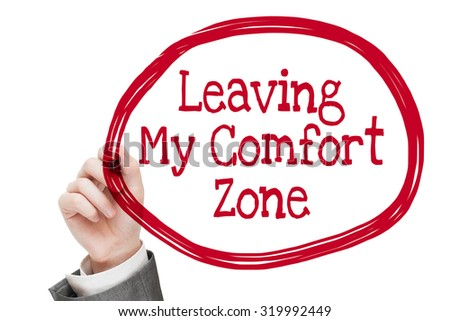 Leaving My Comfort Zone. Man writing motivational message text isolated on white - stock photo