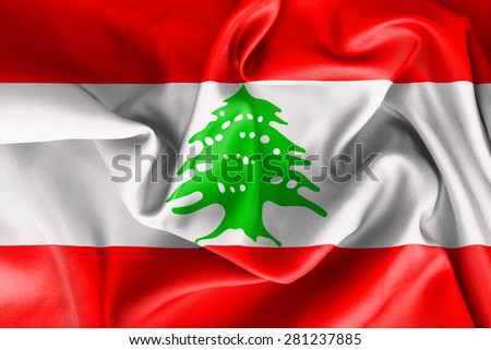 Lebanese flag texture creased and crumpled up with light and shadows