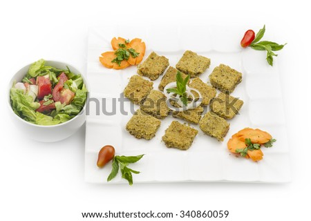 lebanese food of Kibe Hummus , Chickpeas Kibe with Salad  - stock photo